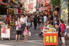 Shoppers walking through Danshui Pedestrian shopping area Royalty Free Stock Photo