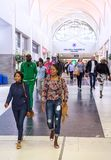 Shoppers walking in Sandton city. royalty free stock image