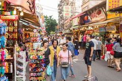 Shoppers walking through Tamsui Pedestrian shopping area Stock Photo