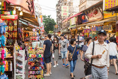 Shoppers walking through Tamsui Pedestrian shopping area Royalty Free Stock Images