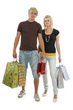 Shoppers young couple. Royalty Free Stock Photography