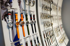 The Shoppes at Marina Bay Sands. SINGAPORE - NOVEMBER 08, 2015: interior of Swatch store. Swatch SA design, manufacture, distribute and service wristwatches sold Stock Photos