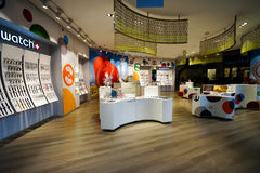 The Shoppes at Marina Bay Sands. SINGAPORE - NOVEMBER 08, 2015: interior of Swatch store. Swatch SA design, manufacture, distribute and service wristwatches sold Stock Photography