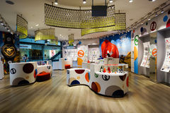 The Shoppes at Marina Bay Sands. SINGAPORE - NOVEMBER 08, 2015: interior of Swatch store. Swatch SA design, manufacture, distribute and service wristwatches sold Royalty Free Stock Photos