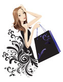 Shopping. Portrait of a pretty woman with shopping bag Royalty Free Stock Images