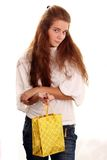 Shopping. Portrait of one happy young adult girl with colored bags Stock Photo