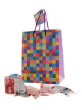 Shopping. Money and shopping bag isolated on the white Royalty Free Stock Photo