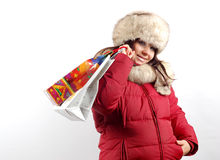 Shopping #12. Attractive woman with shopping bags on white background Royalty Free Stock Photos