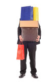 Shopping. Man carrying a pile of shopping wares Royalty Free Stock Photo