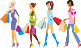 Shopping. Four young fashionable girls walking with shopping  bags Stock Image