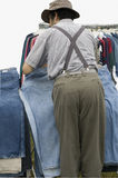 Shopping. Man shopping for jeans at outdoor market Royalty Free Stock Photography