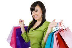 Shopping. Stock image of woman carrying shopping bags, over white background Stock Photos