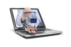 Shopping. Hand reaches out of a laptop with a shopping cart Stock Images