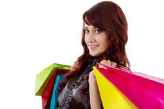 Shopping. Stock image of redheaded woman with shopping bags over white background Royalty Free Stock Images