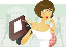 Shopping. Brunette holding shopping bags in front of city scape Stock Image