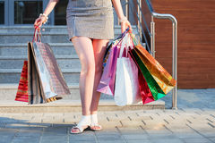 Woman with shopping bags at the mall entrance. Fashion woman with shopping bags at the mall entrance Stock Photo