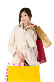 Shopping. Closeup portrait of young business woman holding bags and shopping over white Royalty Free Stock Image