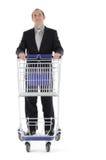 Shopping. Businessman pushing a shopping cart Stock Photo