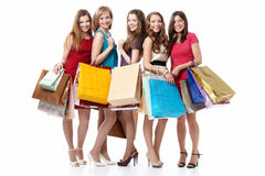Shopping. Five attractive young women with shopping on white background Stock Photos