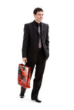 Shopping. Young, fun, a man in a suit comes with a bag in his hands, isolated on a white background Royalty Free Stock Image