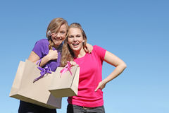 Shopping. Girl teenagers happy shopping with bag from recycled paper Stock Photos