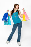 Shopping. Full length shot of teenage girl standing holding gift bags Royalty Free Stock Photography