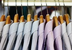 Shopping. Clothes hangers with shirts in the fashion store Stock Images