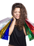 Shopping. Beautiful woman with shopping bags isolated on white Stock Images