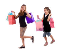 Shopping. Two young sisters show off the rewards of shopping Royalty Free Stock Photography