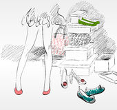 Shopping. Young woman shopping for fashion shoes Royalty Free Stock Image