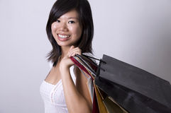 Shopping. Photo of asian girl with shopping bags stock image