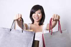 Shopping. Photo of asian girl with shopping bags royalty free stock photography