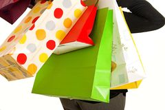 Shopping. Lady with hands full of bags after a day at the shops Royalty Free Stock Photo