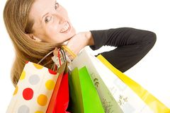 Shopping. Lady with hands full of bags after a day at the shops Stock Photos