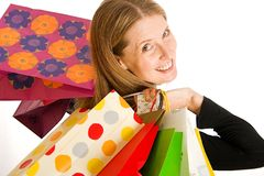 Shopping. Lady with hands full of bags after a day at the shops Royalty Free Stock Image