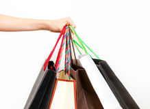Shopping. Female hand holding shopping bags Royalty Free Stock Photos