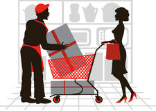 Shopping. A salesman is helping a customer do her shopping Royalty Free Stock Photos