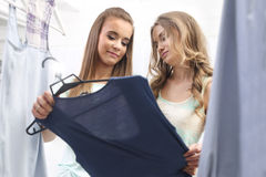 Shopping. Two Women trying clothes in fitting room Stock Photo