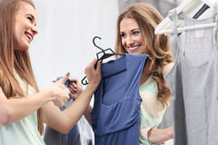 Shopping. Two Women trying clothes in fitting room Stock Images