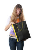 Shopping. The beautiful high girl with a bag for purchases poses on a white background Royalty Free Stock Images