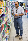 Shopping. Egyptian adult man shopping in the supermarket Stock Images