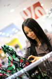 Shopping. Beautiful young woman shopping in a store Royalty Free Stock Photo