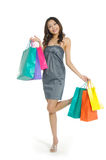 Shopping. Pretty woman with colored package Stock Photo