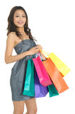 Shopping. Asia Shopping pretty woman with bags Stock Photos