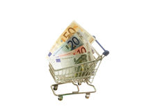Shopping. Model shopping trolley with  euro banknotes on white background Stock Photos