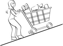 Shopping. Woman pushing a shopping cart Royalty Free Stock Photo