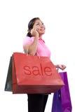 Shopping. Women holding shopping bag on the white background Royalty Free Stock Images