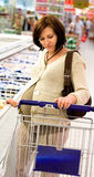 Shopping. Pregnant woman in store-shopping Stock Image