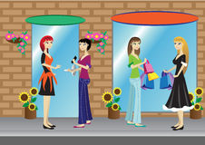 Shopping. Girls in front of some shops Royalty Free Stock Photo