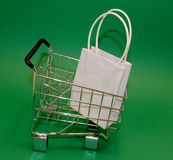 Shopping. Cart with bag Royalty Free Stock Photos
